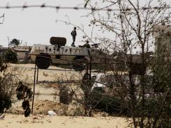 Egyptian border guards patrol near the border with Israel in Rafah, Egypt, on Aug. 6. President Mohammed Morsi is using former jihadists to mediate with radical Islamists in Sinai, trying to ensure a halt in militant attacks in return for a stop in a military offensive.