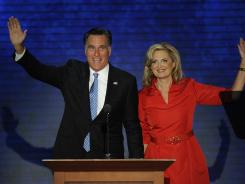 Mitt Romney joins his wife, Ann, on stage at the Republican National Convention in Tampa on Tuesday.