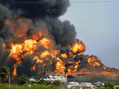 Saturday's explosion and fire at Venezuela's Amuay oil refinery killed at least 41 people.