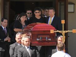 Steven Ercolino's family and girlfriend Ivette Rivera follow his casket out of Our Lady of Sorrows Church Wednesday.
