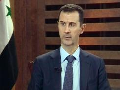 Syrian President Bashar Assad speaks during an excerpt of an interview in Damascus.