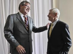 Fred Malek, right, and former Florida governor Jeb Bush chat in Tampa on Tuesday.