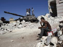 A Syrian man next to the rubble of a damaged mosque in Azaz, Syria, on Wednesday.