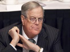 "Billionaire David Koch tells reporters at the Republican convertion, ""I support fiscal responsibility."""