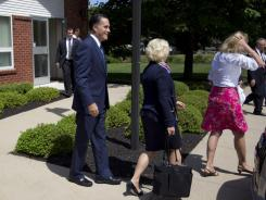 Mitt Romney leaves the Church of Jesus Christ of Latter-day Saints after services on Aug. 19 in Wolfeboro, N.H.