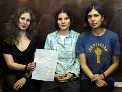 Pussy Riot members, from left, Maria Alekhina, Yekaterina Samutsevich and Nadezhda Tolokonnikova were sentenced to two years in prison on Aug. 17.