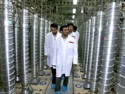 In this April 8, 2008, file photo released by the Iranian President's Office, Iranian President Mahmoud Ahmadinejad, center, visits the Natanz Uranium Enrichment Facility.