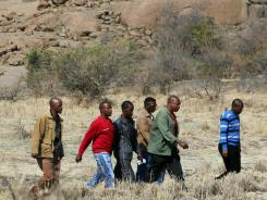 Family members and colleagues of the late mine worker Andries Ntsenyeho, visit the scene of the shooting at the Lonmin Platinum Mine near Rustenburg, South Africa on Friday.