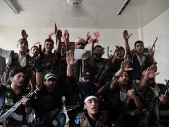 Syrian opposition fighters swear for the liberation of Syria in the northern city of Aleppo, Aug. 29.