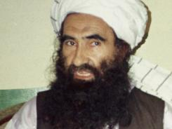 In this 1998 file photo, Jalaluddin Haqqani, then the Taliban Army Supreme Commander, talks to reporters in Waziristan, Pakistan.
