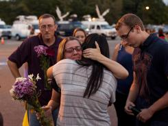 Mourners gather for a candlelight vigil Friday at Old Bridge High School in Matawan, N.J., where shooting victims Christina LoBrutto, 18, and Bryan Breen, 24, both graduated.