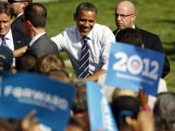 President Obama works the rope line during campaign stop Tuesday on the campus of Colorado State University in Fort Collins, Colo.