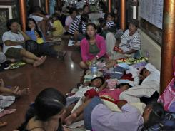 Residents take shelter at the lobby of the city hall in Tandag, Surigao Del Sur province in southern Philippines, following a 7.6 magnitude earthquake on Friday.