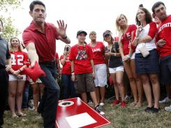 Republican vice presidential candidate Paul Ryan plays cornhole during a tailgate party at the Ohio State-Miami (Ohio) football game on Saturday in Columbus.