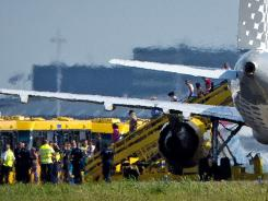 Passengers disembark a plane of the Spanish company Vueling after it landed at Schiphol Airport in Amsterdam on August 29.