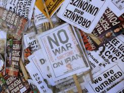 Protest signs lay in a pile in Frazier Park following a march through the Charlotte, N.C., business district before the start of the Democratic National Convention.