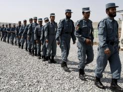 Afghan National Police officers walk in line during their graduation ceremony at a National Police training center in Jalalabad, Afghanistan, on August 30.