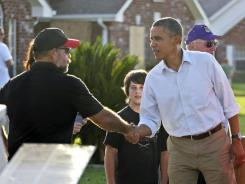President Obama greets resident Monday in LaPlace, La., which was hit hard by Hurricane Isaac.