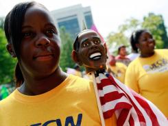"Union supporters march in the ""Charlotte Labor Day Parade"" Monday in Charlotte, N.C."