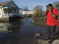 Ron Steward wipes his brow next to the house of his mother, Clara Williams, in Ironton, La., on Monday near Louisiana Hwy 23 in Plaquemines Parish. The house was built seven years ago after her previous home was destroyed by Hurricane Katrina.