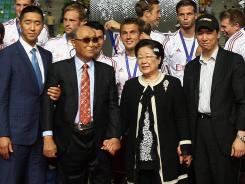 In this July 22 photo, Rev. Sun Myung Moon, second from left, poses with his wife, Hak Ja Han Moon, second from right; his sons Hyung-jin Moon, left, and Kook Jin Moon; during the closing ceremony of the 2012 Peace Cup Suwon in Suwon, South Korea.