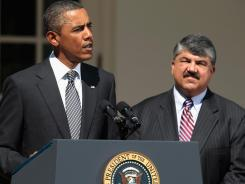 President Obama delivers a statement at the White House on Aug. 31, 2011, as AFL-CIO President Richard Trumka looks on. The AFL-CIO is refusing to financially support this year's Democratic National Convention.
