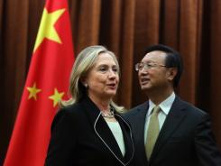 U.S. Secretary of State Hillary Rodham Clinton meets with Chinese Foreign Minister Yang Jiechi at the Ministry of Foreign Affairs in Beijing on Tuesday.