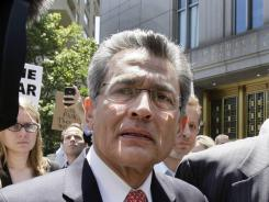 Convicted of insider trading: Former Goldman Sachs director Rajat Gupta, left, and his attorney, Gary Naftalis, leave the federal court in New York in June.