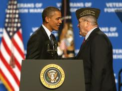 President Obama greets Veterans of Foreign Wars commander in chief Richard L. DeNoyer in Reno July 23.