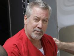 Former Bolingbrook, Ill., police sergeant Drew Peterson arrives at the Will County Courthouse in Joliet, Ill., on May 8, 2009 for his arraignment on charges of first-degree murder in the 2004 death of his former wife Kathleen Savio, who was found in an empty bathtub at home.