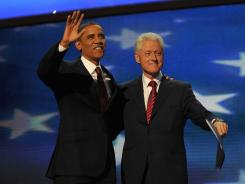 President Obama joins former president Bill Clinton on stage following Clinton's speech at the Democratic National Convention in Charlotte on Wednesday.
