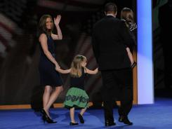 Stacey Lihn waves as she, her husband and her daughters leave the stage at the Democratic National Convention in Charlotte.
