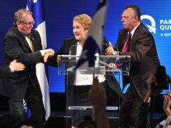 Parti Quebecois Leader Pauline Marois is whisked off stage as she delivered her victory speech in Quebec on Tuesday.