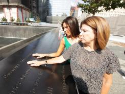 Erin Jackman, left, whose sister Brooke was killed in the Sept. 11 attacks, visits the New York City memorial with her mother Barbara on Saturday.