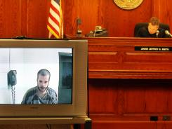 Donnie Inabnit, left, appears via video before Boone County District Judge Jeffrey R. Smith at his initial court appearance in Burlington, Ky.