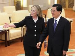 "Chinese President Hu Jintao meets Wednesday with Secretary of State Hillary Rodham Clinton in Beijing. ""There is a huge amount going on where the United States and China need to consult,"" Clinton said."