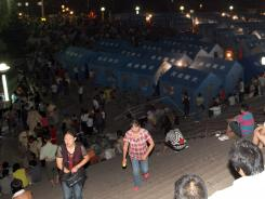 Residents rest at an emergency relief center set up in the town square in Yiliang on Saturday after two quakes hit on the border of southwestern Yunnan and Guizhou provinces an hour apart on Friday.