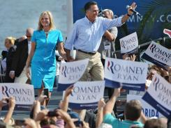 Republican presidential candidate Mitt Romney and his wife, Ann, campaign earlier this month in Jacksonville.