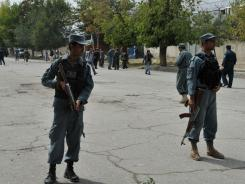 Afghan security forces stand guard at the site of a suicide attack in the city's diplomatic quarters, home to many Western embassies, in Kabul on Saturday.