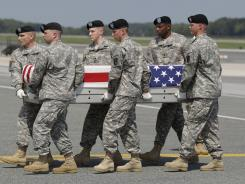 An Army carry team moves the remains of Pfc. Shane W. Cantu of Corunna, Mich., at Dover Air Force Base on Aug. 30. Cantu, who joined his Italy-based Army unit on Sept. 11 last year and deployed to Afghanistan this summer, was among five U.S. deaths announced this past week.