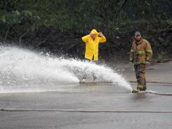 Firefighters pump water out of Lake Tangipahoa in an effort to relieve pressure on Percy Quin Dam, which faced the threat of flooding after being inundated with rains from Hurricane Isaac.