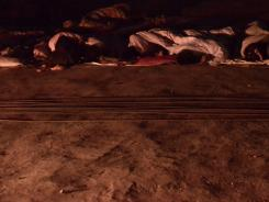 People sleep on a roadside after Friday's quake in Luozehe town, Yiliang county in southwest China's Yunnan province.