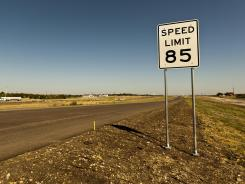 An 85-mph speed limit sign is placed on the 41-mile-long toll road in Austin, near the increasingly crowded Interstate between Austin and San Antonio, Texas.