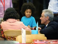 Mayor Rahm Emanuel visits schoolchildren Monday at Woodson Regional Library.