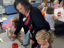 First day of school: Kindergarteners in Wabash County, Ind., begin a class project last month.