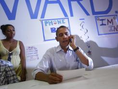 President Obama makes a phone call Sunday during his stop at an Obama for America office in Port St. Lucie, Fla.