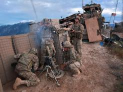 Soldiers fire mortars at a Taliban position last year at Observation Post Mustang in Kunar Province, Afghanistan.