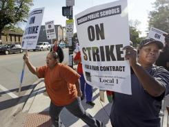 Joining the teachers: Chicago parents walk a picket line Tuesday.