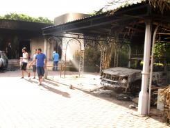 Libyans walk on the grounds of the gutted U.S. consulate in Benghazi, Libya, after an attack that killed four Americans, including Ambassador Christopher Stevens.