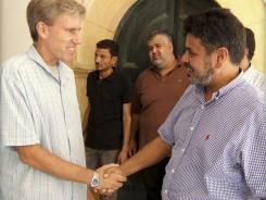Christopher Stevens, the U.S. ambassador to Libya, shakes hands with a Libyan in Tripoli.
